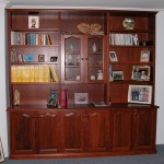 Jarrah wall unit with solid curved arch doors