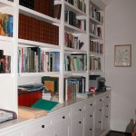Painted white bookcase with shaker style doors and drawer fronts