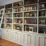 Hampton style painted bookcase / library with a rolling ladder